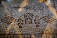 5th century mosaic of Loaves and Fish in The Church of the Multiplication, image Berthold Werner